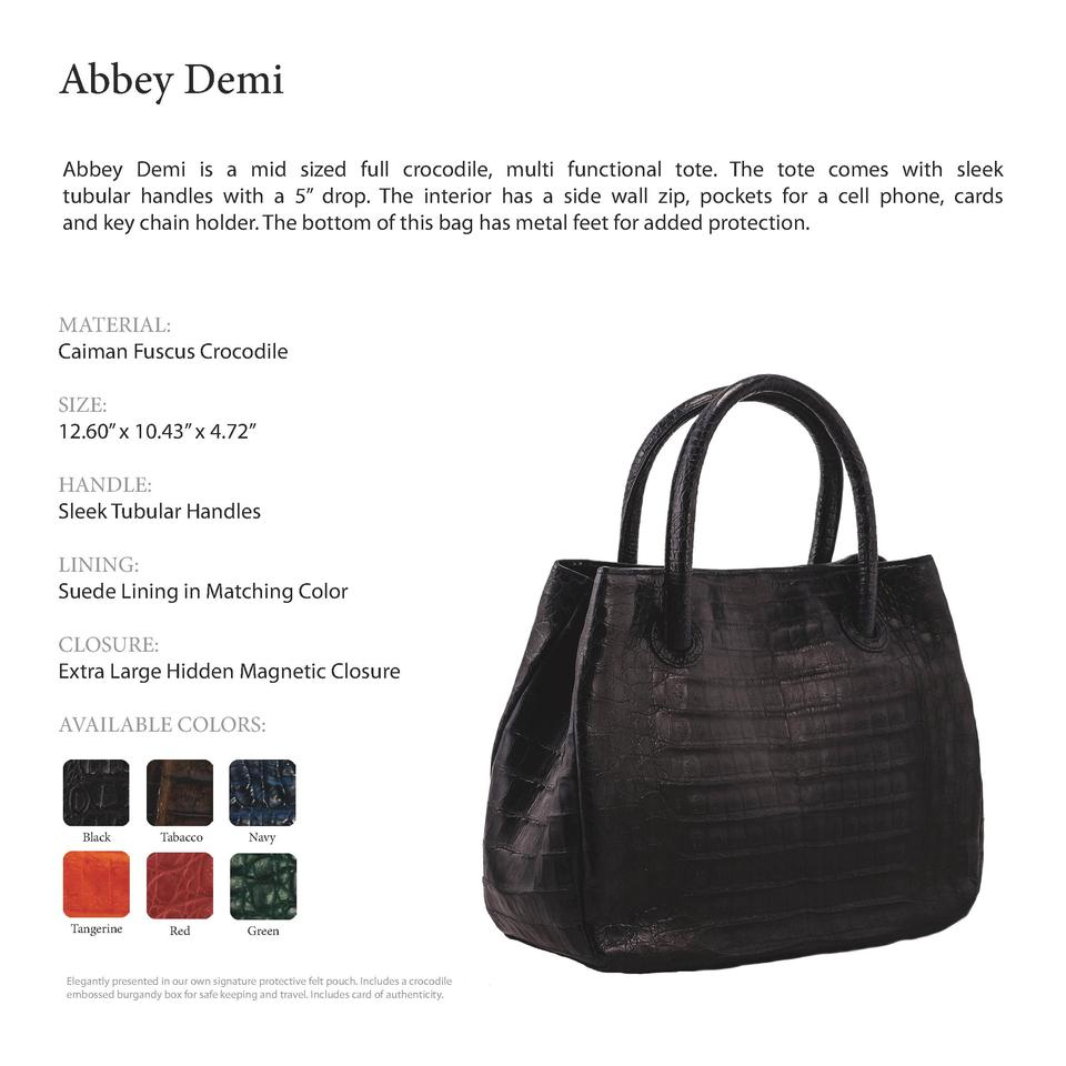 Abbey Demi         Abbey Demi is a mid sized full crocodile, multi functional tote. The tote comes with sleek tubular hand...