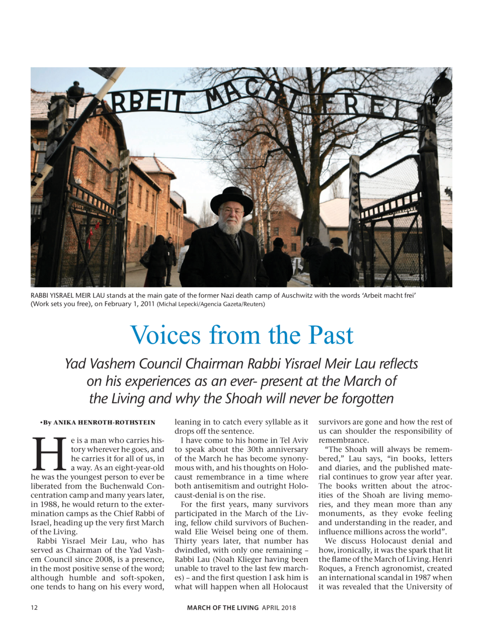 RABBI YISRAEL MEIR LAU stands at the main gate of the former Nazi death camp of Auschwitz with the words    Arbeit macht f...