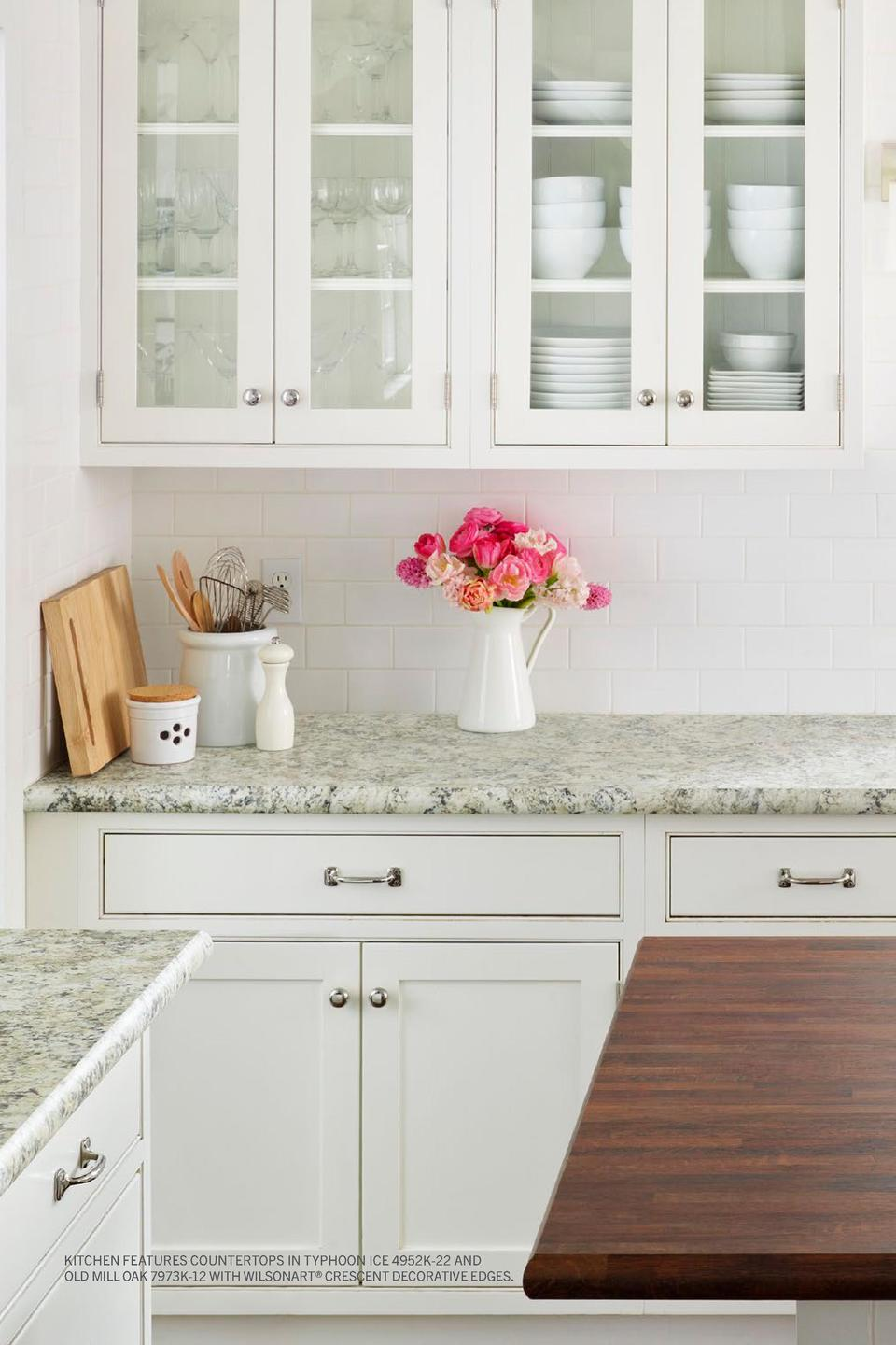 Kitchen features Countertops in Typhoon Ice 4952K-22 and Old Mill Oak 7973K-12 with Wilsonart   Crescent Decorative Edges....