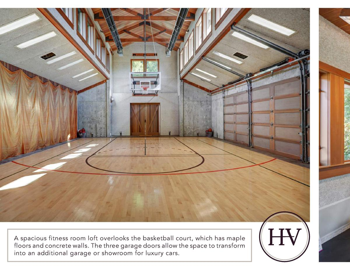 A spacious fitness room loft overlooks the basketball court, which has maple floors and concrete walls. The three garage d...