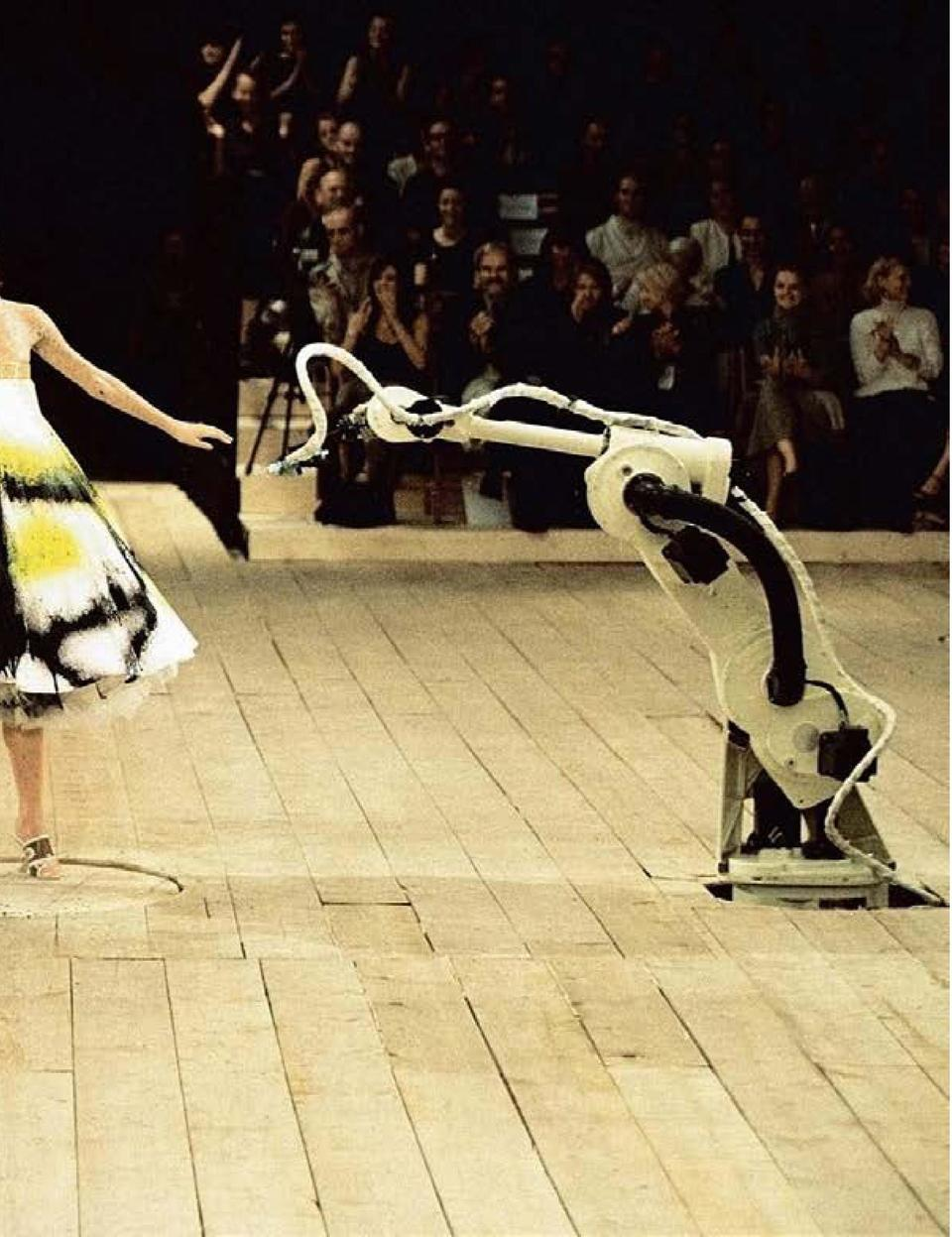 WITH THE COMPANY OF ALEXANDER MCQUEEN   S WORK CALLED    ROTATING ON A TURNTABLE   , WEARING A WHITE DRESS, BEING SPRAY-PA...