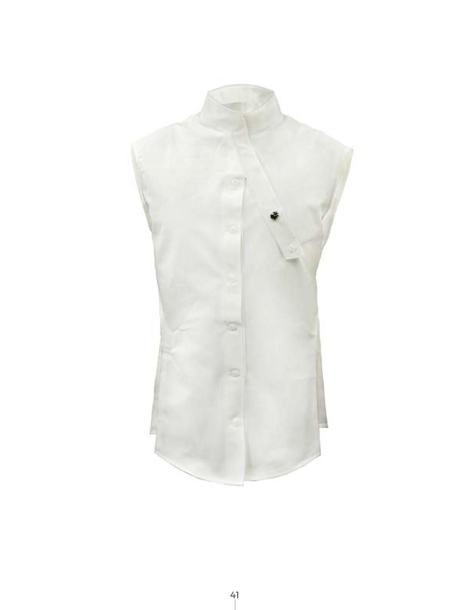 T  he original Oxford Weaved fabric in pearl white, made by Scottish fabric mills was used by Mike. The shirt was designed...