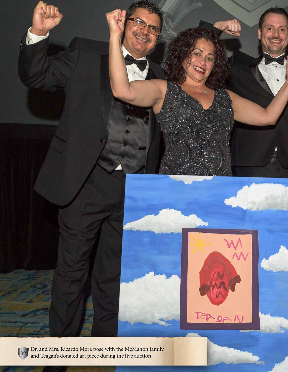 Dr. and Mrs. Ricardo Mora pose with the McMahon family 32 and Teagan   s donated art piece during the live auction